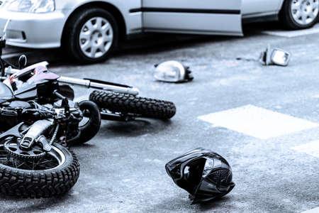 Helmet and motorcycle on the street after car crash Stok Fotoğraf