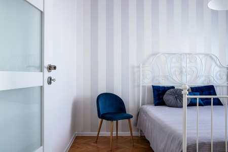Grey, white and blue design of trendy bedroom interior with king size bed