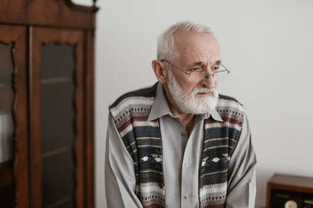 Sick worried older man spending time alone in his home Zdjęcie Seryjne