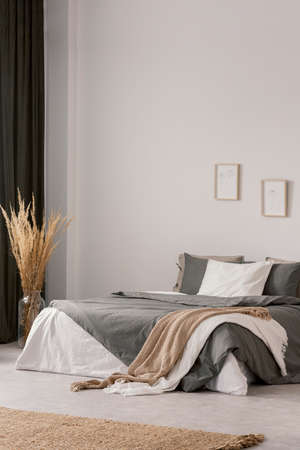 Elegant bedroom interior with beige carpet on the floor
