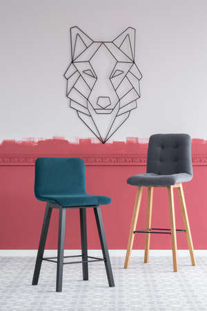 Emerald green and grey velvet bar stools in empty interior with burgundy and white ombre wall Zdjęcie Seryjne