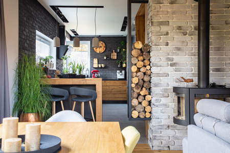 Stylish and trendy kitchen with black brick wall in modern home