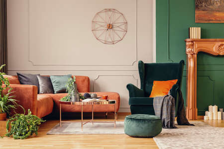 Stylish copper colored coffee table in front of comfortable corner sofa in trendy living room