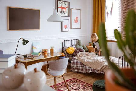Trendy bedroom interior with bed and desk for school kid Zdjęcie Seryjne