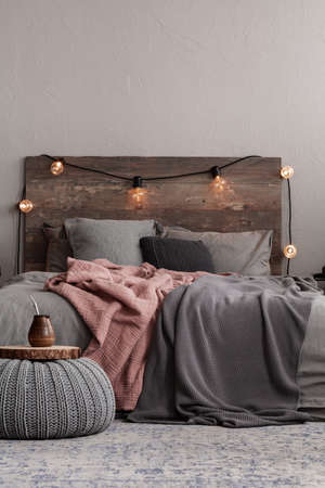 Trendy rustic bedroom design with grey and paste pink bedding