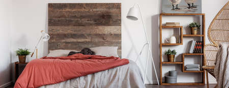 Panoramic view of trendy bedroom in rustic style