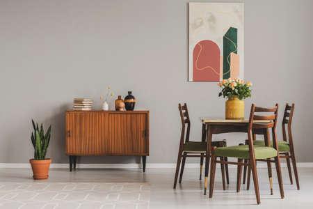 Vintage cupboard in grey elegant living room interior, copy space on empty wall