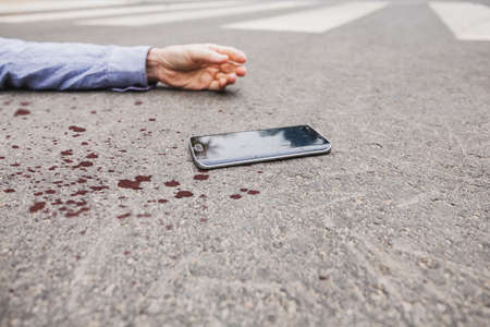 Man in a blood without his phone after the accident