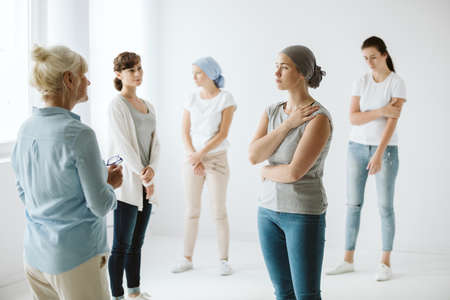 Women after chemotherapy exercising on a session of psychotherapy