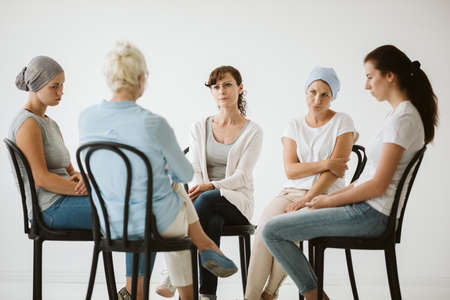 Group of women after chemotherapy sitting in the circle