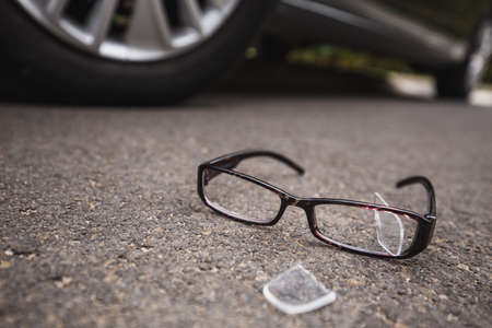 Close-up of broken glasses near the car