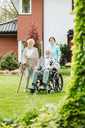 Sunny afternoon in the garden of nursing home for elderly Stock Photo