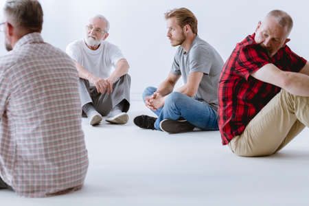 Therapy with its emphasis on vulnerable face-to-face sharing, presents challenges for men Stock Photo