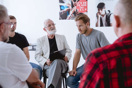 Group psychotherapy for men with different problems and issues Stock Photo