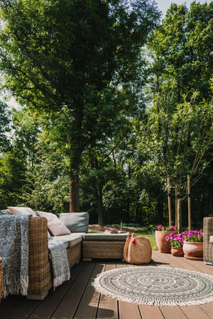 Elegant garden furniture on terrace of suburban home Stock Photo
