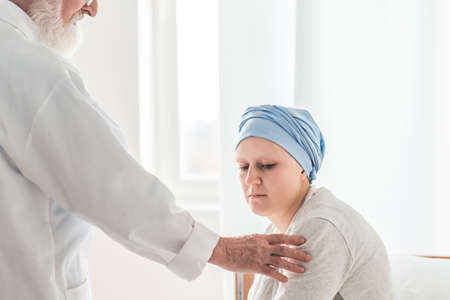 Older physician sharing the sad diagnosis with young patient