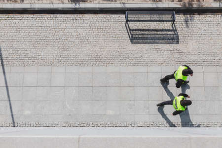 Top view of two police officers walking down the street