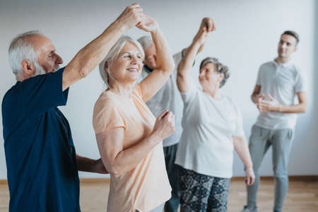 Older people dancing with their partners on a dancing course