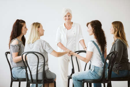 Group of young women supporting each others during psychotherapy