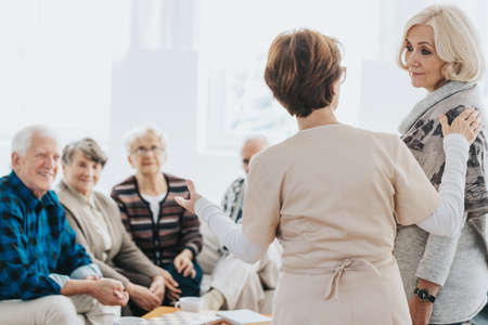 Volunteer helps seniors living in a care home for elderly