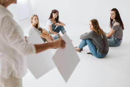 Four young women on a therapy working in a group