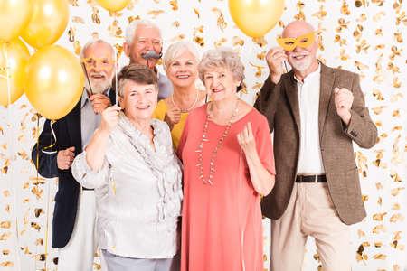 Group of happy senior people celebrating and having fun together Standard-Bild