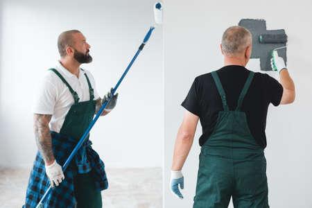 Professional renovation crew painting walls of new build apartment Standard-Bild