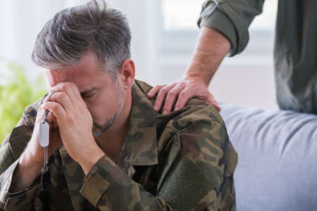 Middle aged soldier with trauma during psychotherapy