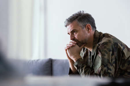 Former soldier thinking about the past during psychotherapy
