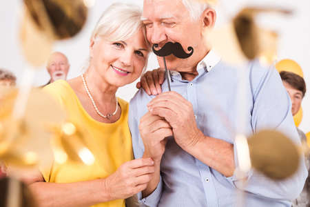 An elegant senior couple having fun on New Year's Eve party