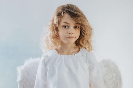 Cute young blond hair child dressed up as an angel