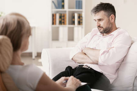 Handsome man with post traumatic stress during psychotherapy
