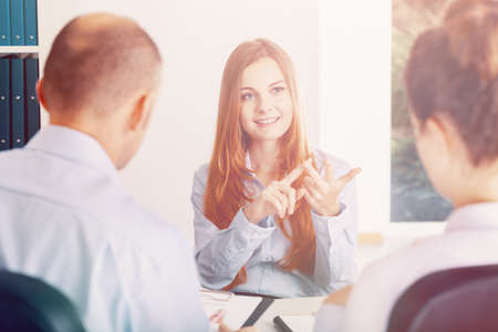 Confident young woman pointing her advantages during the recruitment interview