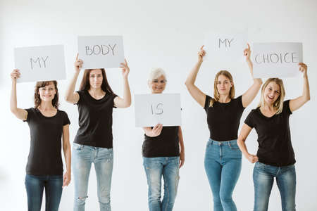 Group of women wearing black fighting for rights to abortion