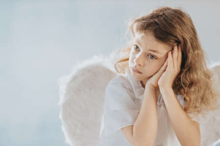 Picture of sad little angel praying to the God