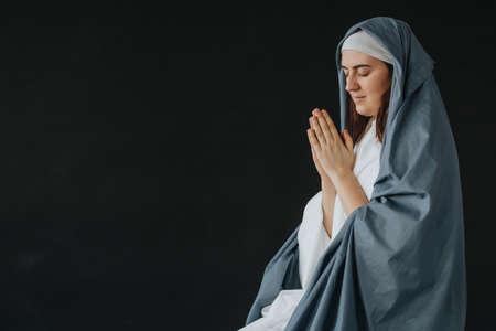 Mother of God praying on a black background Stok Fotoğraf