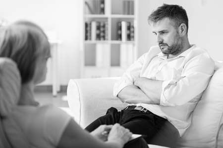 Handsome man with post traumatic stress during psychotherapy Stok Fotoğraf