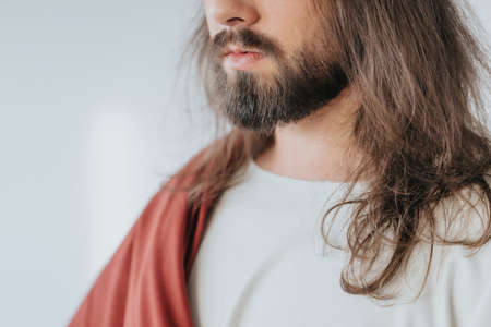 Close-up of Jesus Christ wearing white and red robes
