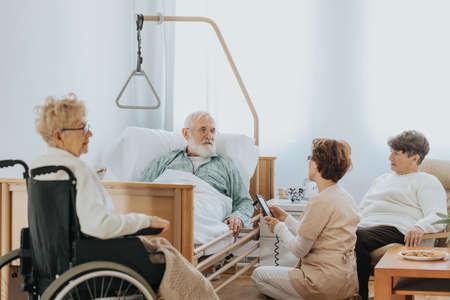 Grpup of older people spending time together in nursing home Stok Fotoğraf