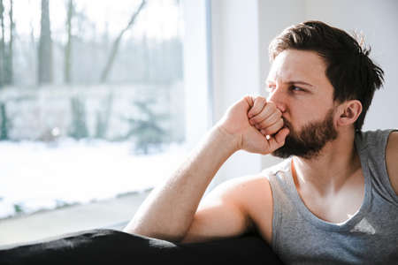 Young lonely man at home after restless night