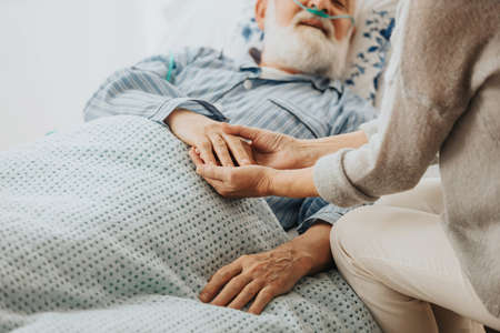 Close-up of older dying man holding his wife's hands Stok Fotoğraf