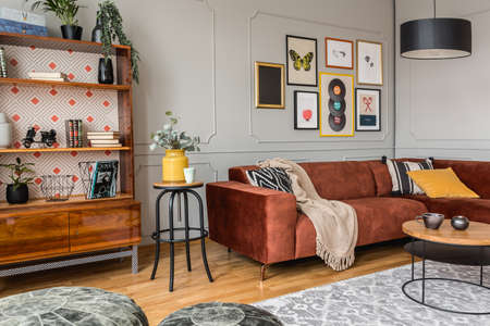 Vintage black poufs in trendy eclectic living room interior with brown couch Stok Fotoğraf