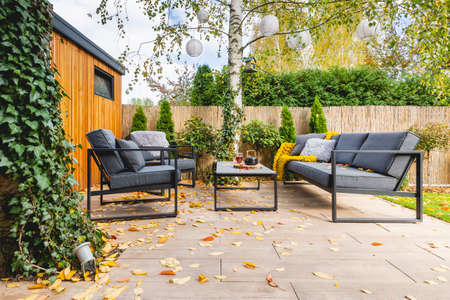 Gray furniture in the garden of elegant home