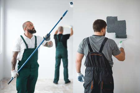 Professional renovation crew painting walls of new build apartment Stok Fotoğraf