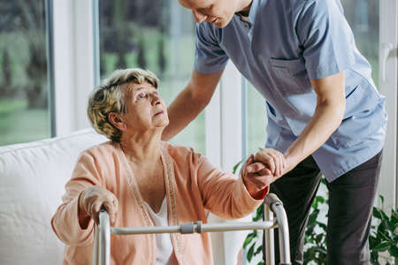 Older woman in nursing home spending time with a caregiver