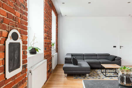 Red brick wall in contemporary apartment interior