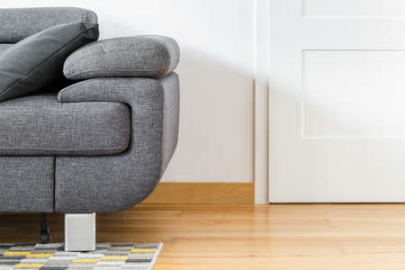 Close up of gray sofa in white room interior Stock Photo