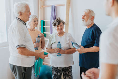 Group of senior people exercising together on a gym Stock Photo