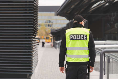 Word police written on reflective vests of police officers Stock Photo