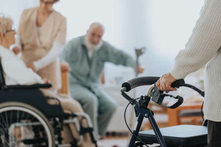 Caregiver helping older disabled people with daily activities